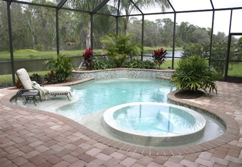 semi indoor small garden swimming pool design with paved