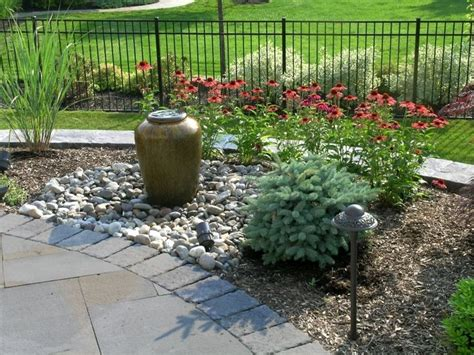 landscape design includes  jar fountain    relaxing sound  running water