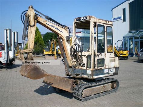 nissan  mini excavator  minikompact digger construction equipment photo  specs
