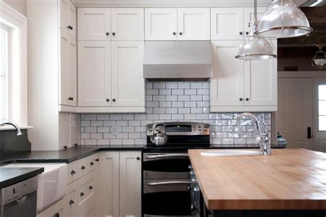 white kitchen with white subway tile soapstone counter with butcher block counter subway 2107