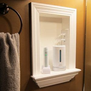 bathroom medicine cabinets with electrical outlet remove medicine cabinets and add a built in shelf and put