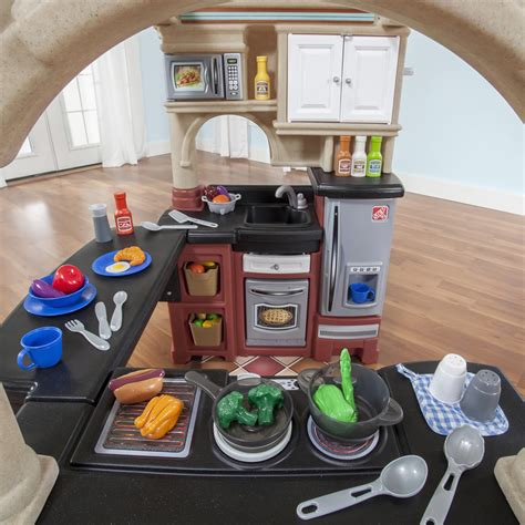 grand walk in kitchen and grill grand walk in kitchen with play food set step2