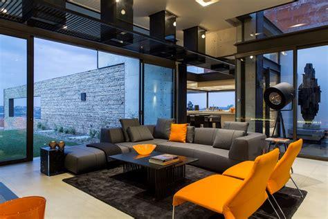grey sofa orange chairs rug coffee table luxurious