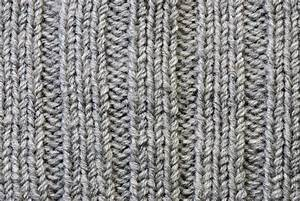 Grey Knitting Background Of Handmade Woolen Pattern