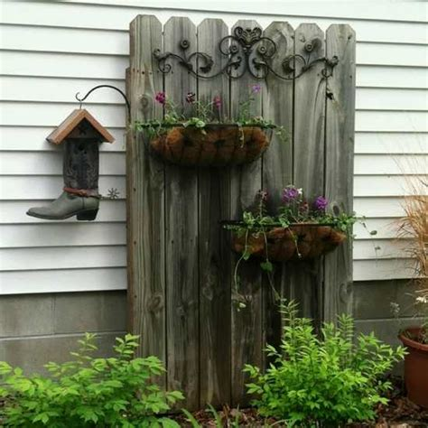 recycled crafts turning clutter into creative garden decorations