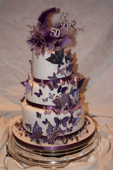tier wonky cake  purple butterflies cake