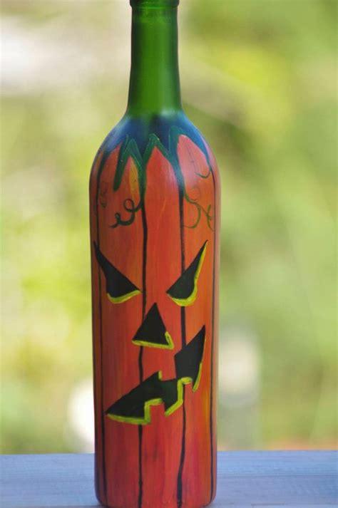 painted lighted wine bottle halloween jackolantern