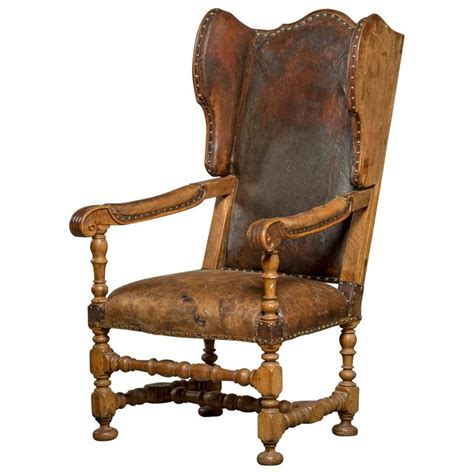 leather upholstered wingback chair in walnut for