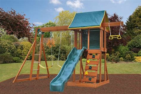 screens for gardens meadowside climbing frame with slide rock wall and swings