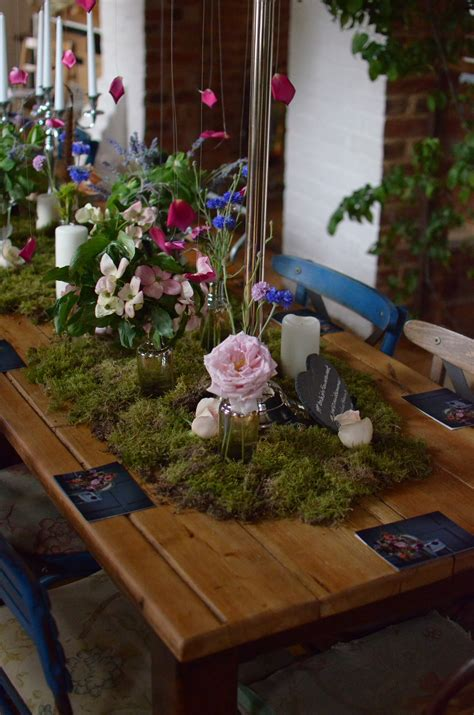 Moss runners and flowers bottles Table decorations