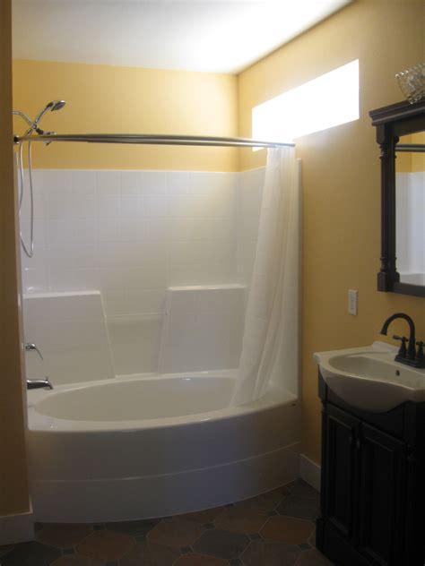 corner bathroom design idea for small space with oval tub