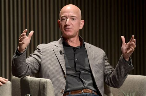 Bezos Dares Rivals to Raise Wages, Walmart Fires Back: Pay ...