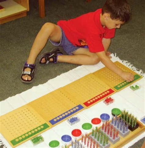 montessori math materials and curriculum for all age 785   boy with long division