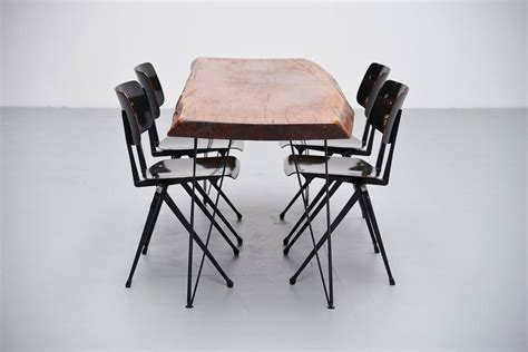 tree trunk dining table with hairpin legs 1950