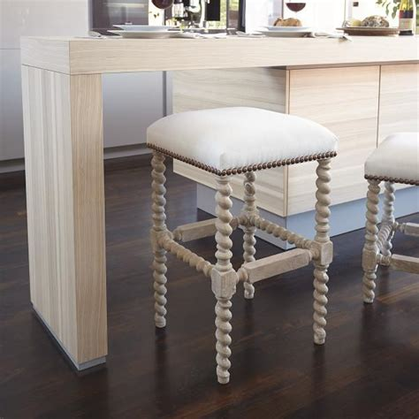 beige  white spindle legs bar stool