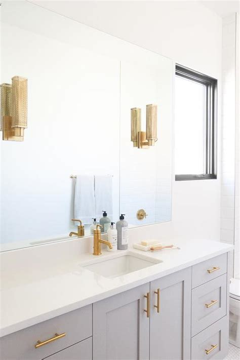 light gray washstand  brushed gold faucet