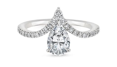 Upside Down Engagement Ring Trend  Purewow. Princess Cut Engagement Rings. Western Rings. Management Engagement Rings. Artistic Wedding Rings. $70000 Engagement Rings. Scar Rings. Cute Wedding Engagement Rings. Sunglasses Engagement Rings
