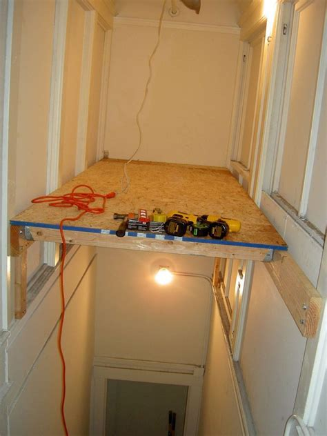 above stairs storage ideas turn an empty stairwell into a storage loft empty lofts and storage