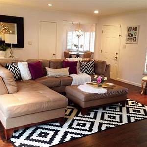 Black and white area rug in the living room pops of for Sectional sofa area rug