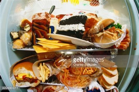 id馥s cuisines refrigerator bulging with junk food stock photo getty images