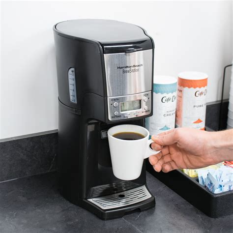 The machine is easy to use and the internal storage tends to keep the coffee hot for longer than a carafe would. Hamilton Beach 48464 BrewStation Summit Black Single Serving 12 Cup Coffee Maker with Auto Shut Off