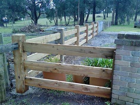 rural timber post  rail formal entrance fencing