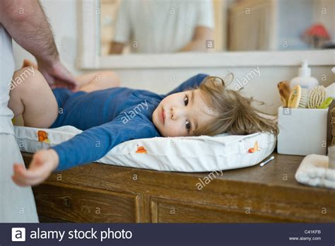 Father Changing Baby's Diaper Stock Photo