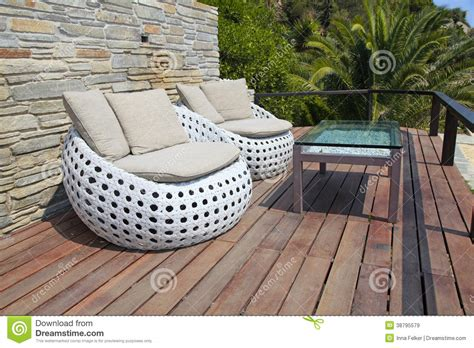 white outdoor furniture  wood resort terrace stock image