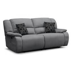 comfortable two seater reclining charcoal sofa and two cushions as modern living room seater