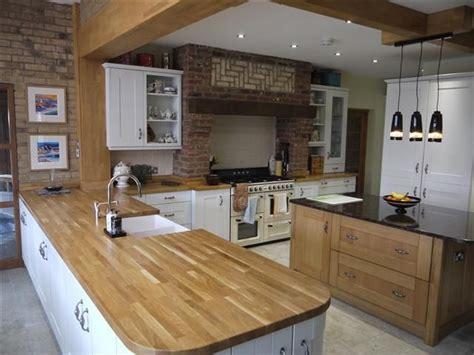 hanging cabinets in kitchen granite solid oak worktops kitchen oak 4135