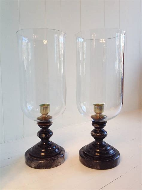 large glass hurricane ls pair of large black marble and glass hurricanes at 1stdibs