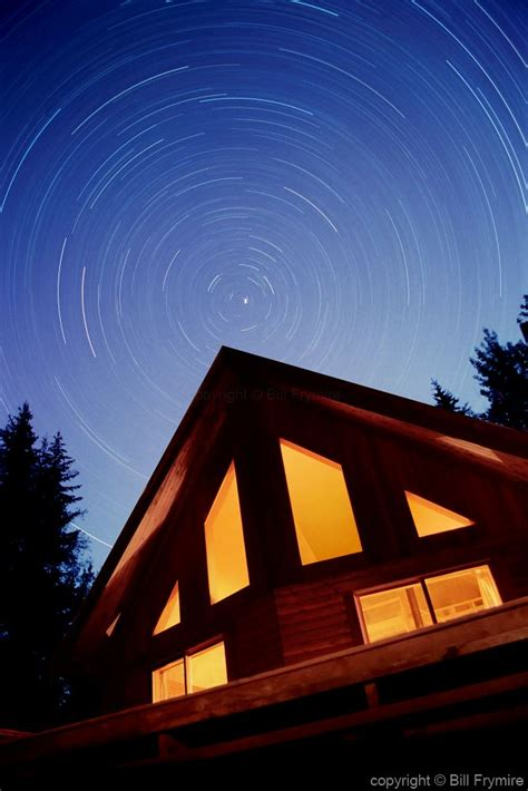 cabin  night  star trails