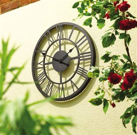 black numeral indoor and outdoor wall clock 34cm by