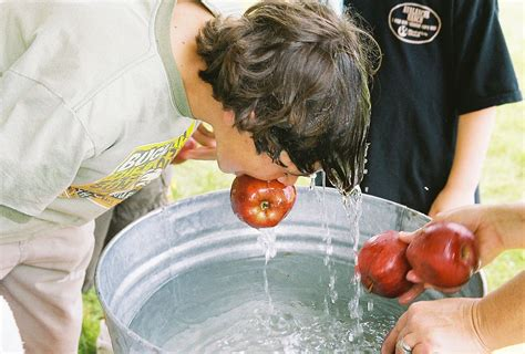 three in a tub meaning apple bobbing