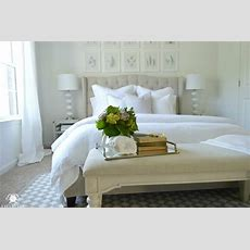 Guest Bedroom With White Bedding And Bench At Foot Of Bed