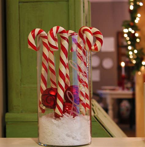 decorating with canes for christmas jumbo candy canes in a hurricane jar the inspired room