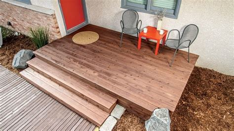 build a front deck your concrete stairs for added