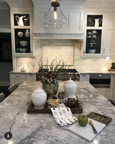 kitchen with white backsplash kraus designs llc white cabinets gray 6560