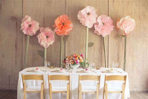 oversized decor head table setup giant paper flowers articles easy weddings