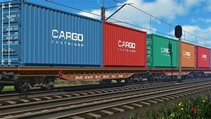 Freight Train With Cargo Containers Passing By Stock ...