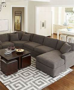 13 clever design tips and tricks for small spaces for Rug under sectional sofa