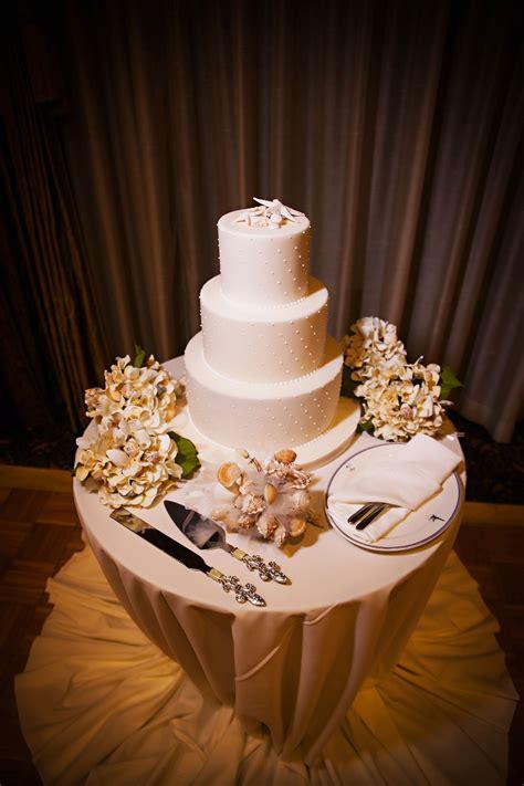elegant  tier starfish topped wedding cake