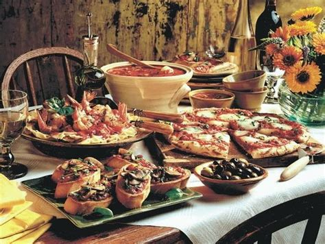 table mountain seafood buffet rustic italian food booth table pizza pasta meats