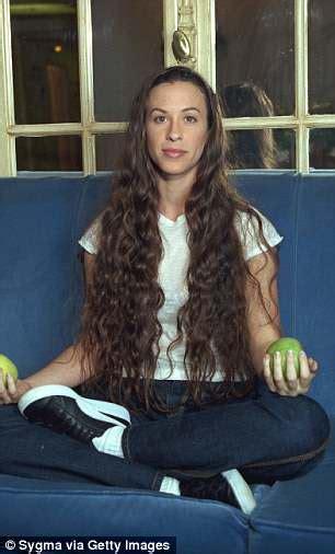 Alanis Morissette looks almost unrecognizable as she ...