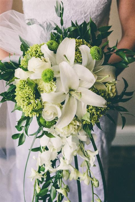 cascading bridal bouquet  white oriental lilies roses