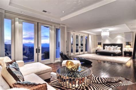 home designer suite contemporary master bedroom with chandelier hardwood