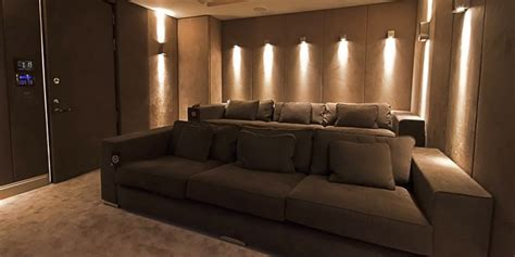 1 home cinema with wall sconce lighting basement