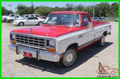 dodge ram   original mileage red classic dodge truck