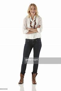 Attractive Young Woman Standing With Her Arms Crossed ...