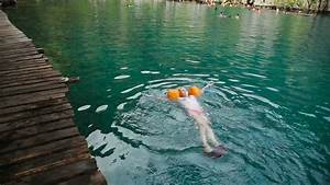 Young Girls Swimming In The Beautiful Mountain Lake Under ...